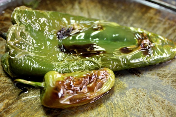 Drizzle olive oil over the poblano and jalapeno and roast for about 5 minutes...