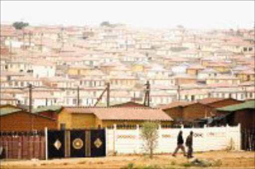 HOME SWEET HOME: The National Housing Finance Corporation and Absa are committed to build 100 000 houses for low-income earners before 2010. Pic. Marianne Schwankhart. 26/11/07. © Sunday Times.