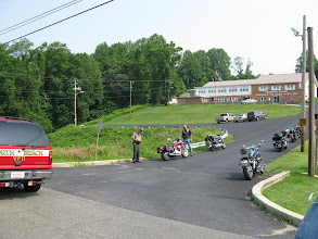 Photo: Her motor bike made out better then she did, there sure must be a lot of numbers on that license plate -  that cop has been standing there writing for a while now