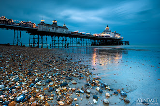 Photo: Twilight | Blue Hour at Eastbourne Pier in East Sussex - Eastbourne, U.K.  Just had a lovely time driving down south to East Sussex on a rare weekend with some sun. It was blustery for the most part, but at least there was no rain for a change. Eastbourne reminded me of Brighton, only much quieter and less crowded and better suited for a weekend where you just want to mix business with a bit of pleasure.  ... One of the last remaining Victorian piers in England, Eastbourne Pier is a seaside pleasure pier in East Sussex. Formally opened by Lord Edward Cavendish in 1870, the pier is built on stilts that rest in cups on the seabed allowing the whole structure to move during rough weather. At the end of the pier is a tower that is often used as a viewing point during the annual air show. The city of Eastbourne, dubbed as the sunniest place in England, attracts over 4 million visitors a year.  #Eastbourne   #England   #UK   © Yen Baet - www.YenBaet.com. All Rights Reserved. Join me on Facebook at www.facebook.com/YenBaetPhotography.