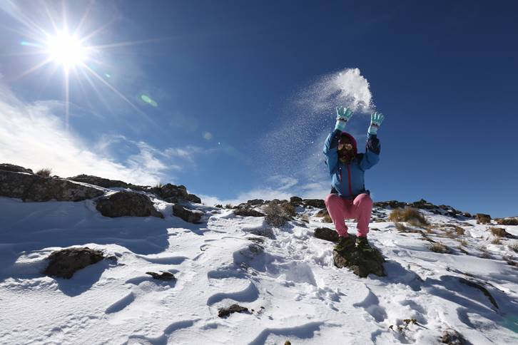 Mapaseka Makoae, a tour guide from Lesotho, enjoys the snow at Black Mountain.