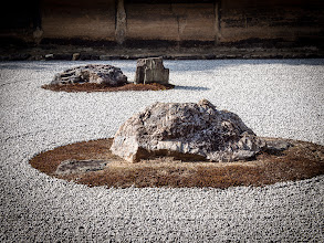Photo: Royanji Temple Zen Garden The garden is thought to date from the mid 15th century.  A rock and gravel garden comprising 15 rocks in 5 groupings, arranged on a bed of white gravel, it is renowned throughout the world as the ultimate example of the karesansui or dry landscape style rock garden, in which nature is compressed and given abstract expression within the confines of a very narrow space.