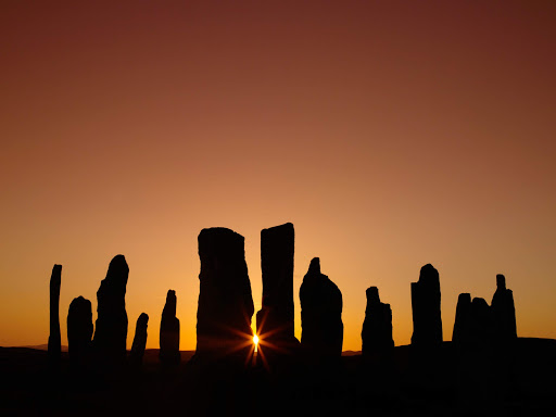 The Callanish Stones are an arrangement of standing stones dating to the Bronze Age and located on the Isle of Lewis in Scotland.