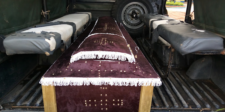 The coffin is carried away in a police vehicle in Kwale on July 3, 2020.
