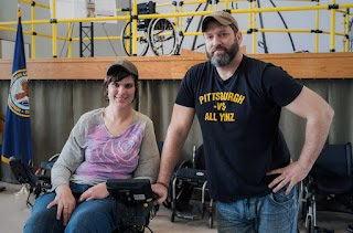 Matt and his friend Jess Burkman in the MeBot wheelchair at the Human Engineering Research Lab (HERL).