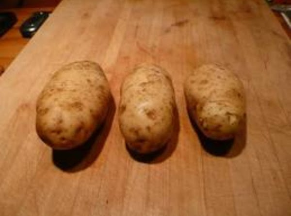 Cook potatoes in boiling salted water about 20 minutes. Drain and rinse with cool...