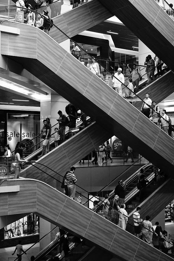 Geometrical movement by Alejo Cedeno - City,  Street & Park  Markets & Shops ( abstract, robots, streetphotography, chileando, monochrome, escalators, street, travel, zigzag, people, geometry, panama, contrast, urban, blackandwhite, chile, assemblyline, movingpeople, urbangeometry, santiago, diagonal, lines )