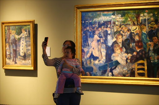 Those of us who want to admire art - like Renoir's 'Dance at le Moulin de la Galette' - in an atmosphere of decorum would like a ban on people taking selfies in museums and galleries