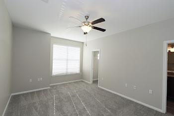 C4 floorplan spacious bedroom with plush carpet