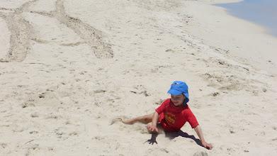 Photo: Ethan enjoying the beach
