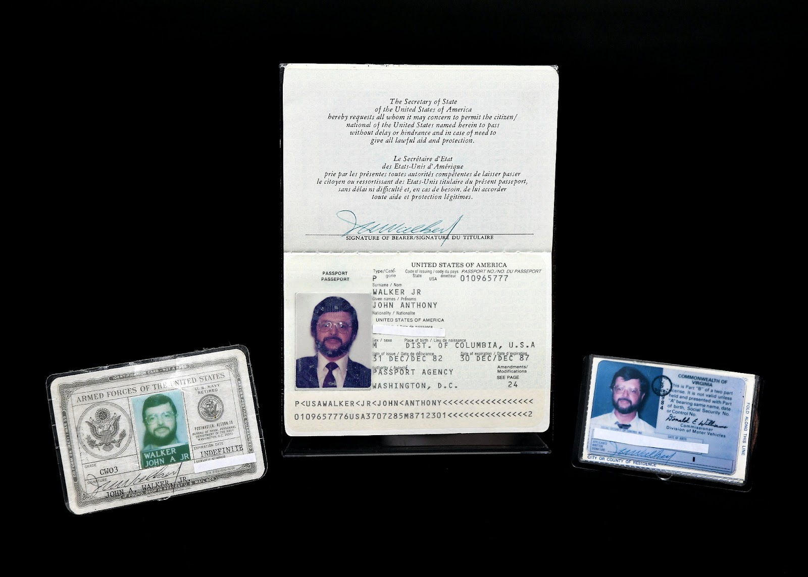 Identification documents used by convicted traitor John Anthony Walker Jr., a former U.S. Navy Warrant Officer who sold U.S. secrets to the Soviet Union during the Cold War. Walker was sentenced to life in prison.