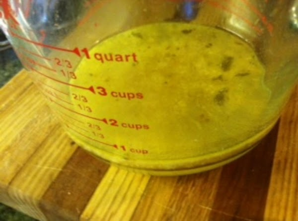 Pour marinade broth into a microwave safe container.  Return chicken into oven for...