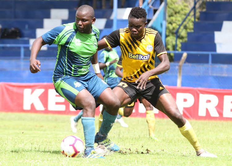 KCB's Enock Agwanda and Stephen Otieno of Sofapaka in a past tussle