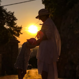 Granddaughter with grandmozher by Robert Seme - People Family ( croatia, photooftheday, islands, grandmother, island, sunset, adriatic, vacation, photo, sunsets, granddaughter, photography,  )