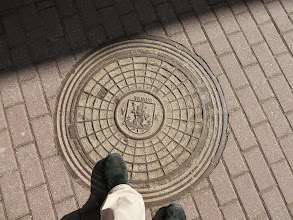 Photo: Manhole cover with St Christopher