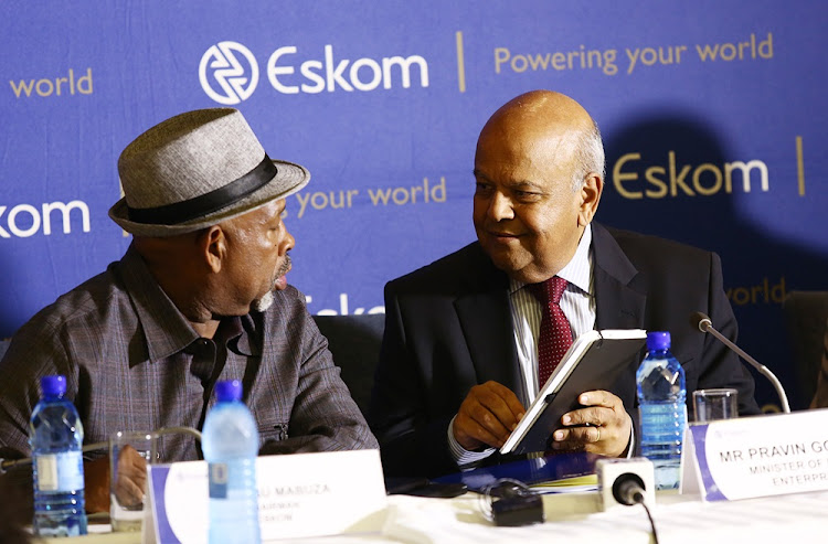 Eskom chairperson, Jabu Mabuza, talks to minister of public enterprises, Pravin Gordhan, before briefing the media about the power outages that have hit the country on December 6 2018.