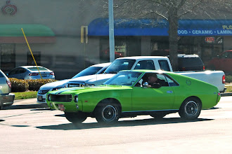 Photo: A rare AMC AMX (1969?) spotted at an intersection yesterday. Only about 19,000 were produced from 1968-1970. http://en.wikipedia.org/wiki/AMC_AMX