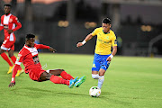 Godfred Asante of  Horoya  and Gaston Sirino of Mamelodi Sundowns during the CAF Champions League match.