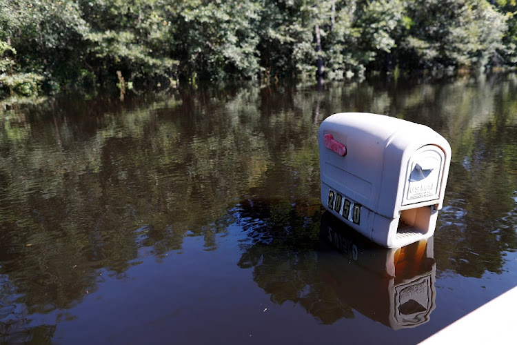 A mailbox is partially submerged by flood waters in the aftermath of Hurricane Florence, now downgraded to a tropical depression, in Conway, South Carolina in the US, on September 19 2018. Picture: REUTERS/RANDALL HILL