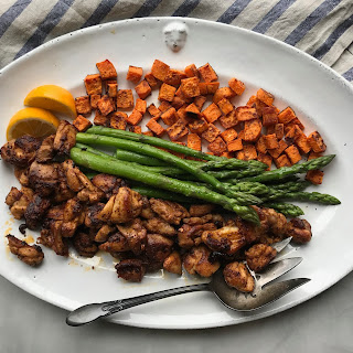 Whole30 Crispy Chicken with Asparagus and Sweet Potatoes.