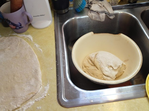 Dump dough out of bowl onto floured counter, gently working flour in, just to...