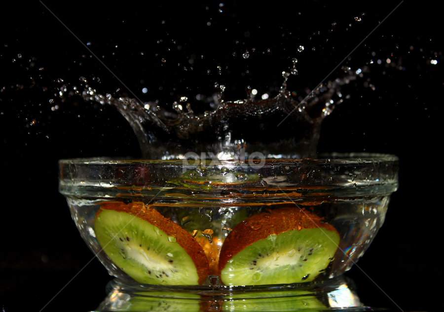 by Dipali S - Food & Drink Fruits & Vegetables ( water, fruit, splash, kiwi, food, green, artistic )