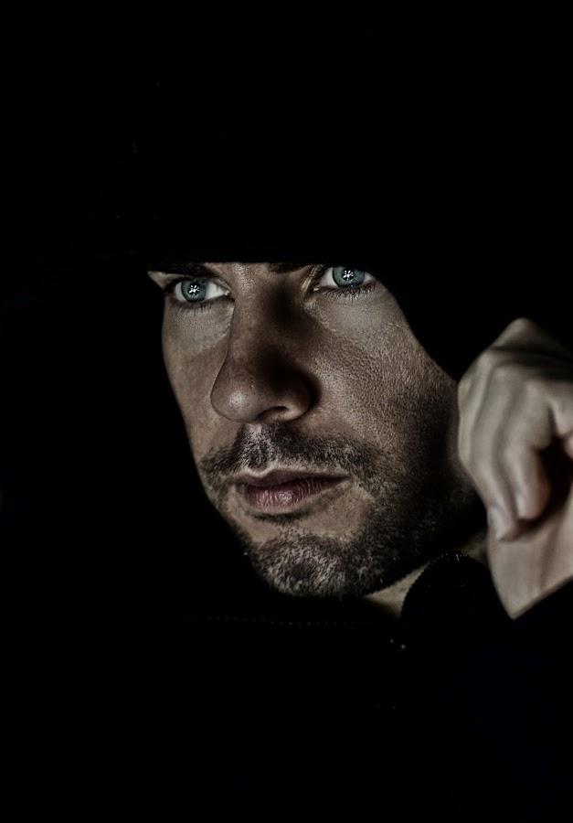 hooded man by Beatrix Bagdi - People Portraits of Men
