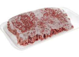 A package of frozen hamburger meat.