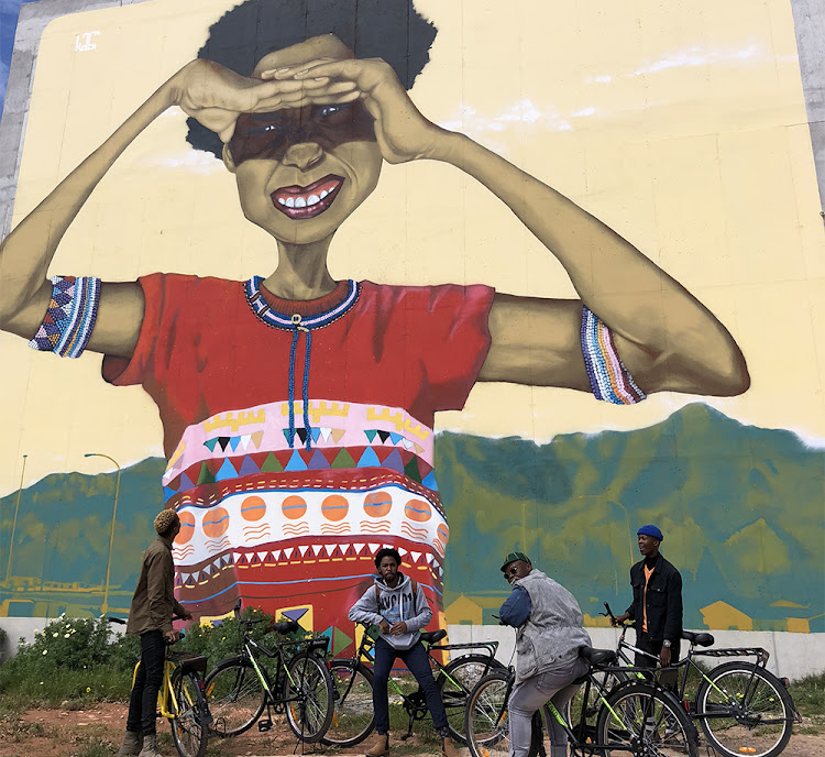 Social 'activator' Siyabonga Mbaba hopes his cycle tours through Khayelitsha will help visitors see the township in a new light - as a place of creativity and innovation. Mural created by Breeze Yoko.