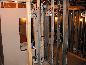 Photo: Looking into the 'media closet'. Equipment rack will go were opening is. This closet will make for easy access to wiring and connections.