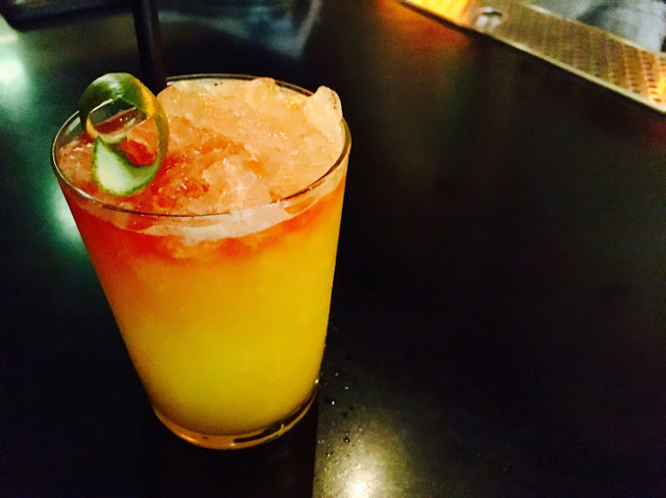 The Comal Swizzle with mezcal, Falernum, pineapple, passion fruit and lime.