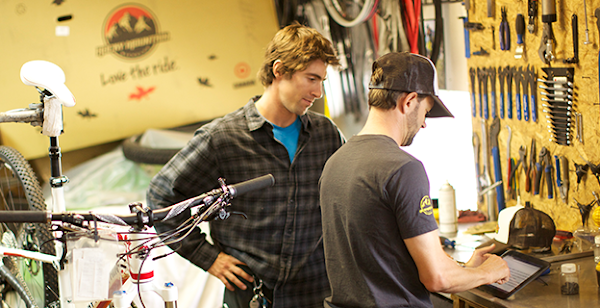 two men in a bike and hardware store