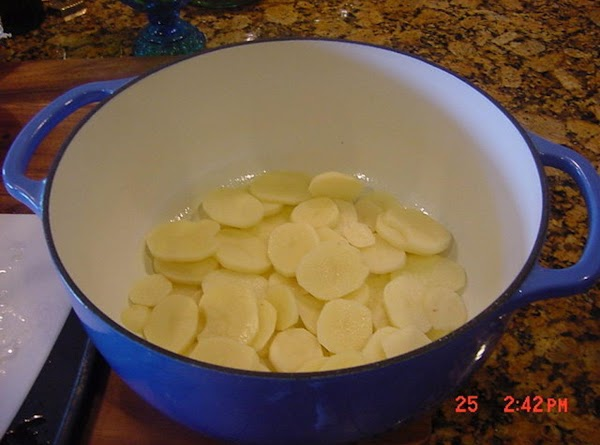 Add 1/2 of the potatoes to the bottom of the dutch oven and season...