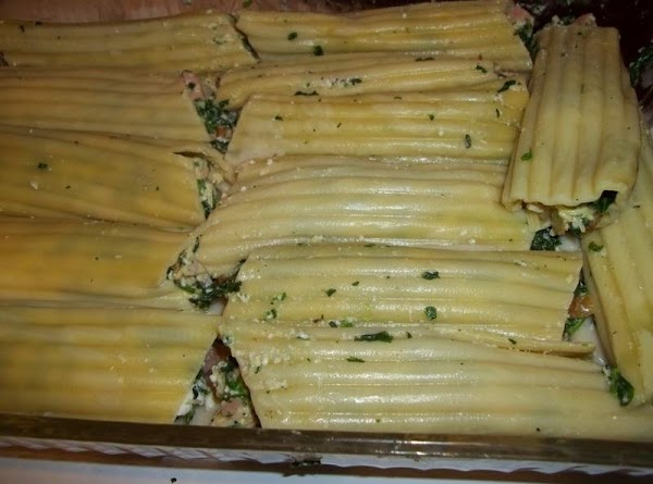Once all are stuffed and placed side by side in dish. Cover with sauce...