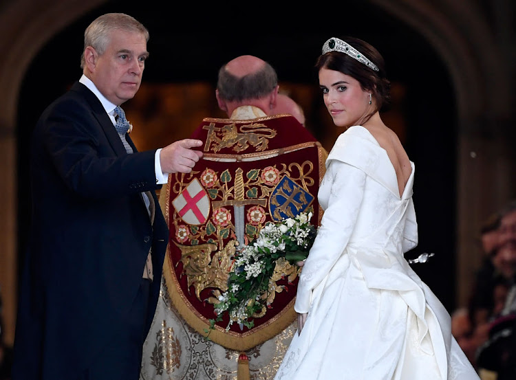 Princess Eugenie of York and her father Prince Andrew, Duke of York, arrive ahead of her wedding to Mr Jack Brooksbank at St. George's Chapel on October 12 2018 in Windsor, England.