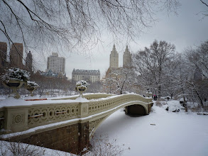 Photo: Bow bridge covered in snow.   Central Park, New York City.  View the writing that accompanies this post here at this link on Google Plus:  https://plus.google.com/108527329601014444443/posts/j5baWNLQhFZ  View more New York City photography by Vivienne Gucwa here:  http://nythroughthelens.com/