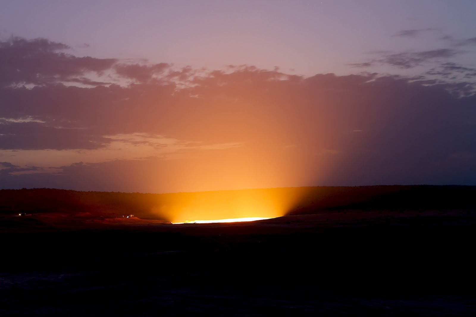 """The glow of a flaming crater of methane gas called the """"Gates of Hell"""" in Derweze, Turkmenistan, a popular tourist site for the little traveled country."""