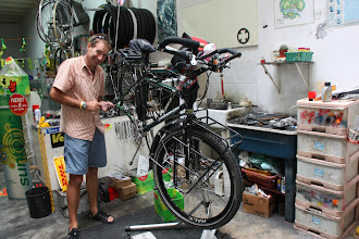 Photo: Year 2 Day 108 -  Rog and Sally in the Bike Shop in Georgetown