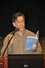 Photo: Paul E. Nelson reads his work from the RASP poetry anthology.