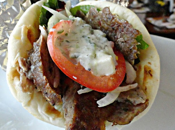 Build you gyro: flat bread, sauce, lettuce, gyro slices, tomato, onions and top with...
