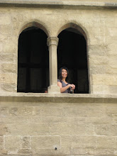 Photo: Peichi snaps a photo from a second floor window.