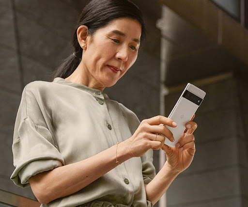 An image of a female small business owner using her Google phone for work.