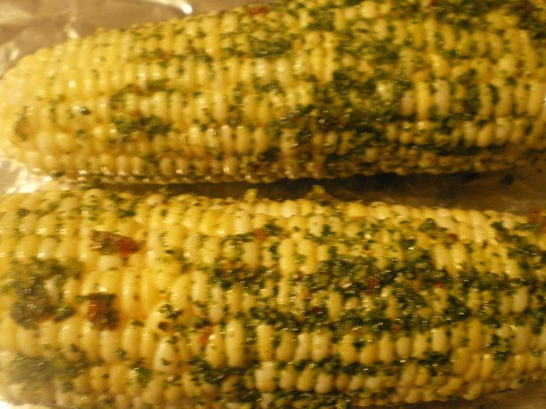 On aluminum foil brush corn with pesto.  Sprinkle with salt and pepper.