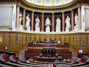 Photo: The Chamber where the Senate holds its sessions was built from the plans of architect Alphonse de Gisors from 1836 to 1841. The Senate Chamber is made up of two hemicycles: a larger one where the Senators sit and this smaller adjoining one, where orators stand, and the President of the Senate sits to preside over the debates.