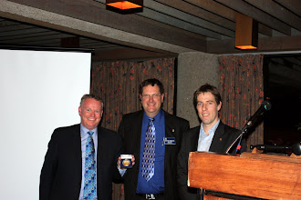 Photo: Paul Green of Enbridge accepts an award from ASHRAE for their generous donations over the years