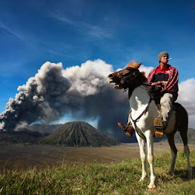 Bromo's Horseman II by Perak Man - Landscapes Travel ( tenggerese, mount bromo, caldera, volcanic, travel, people, eruption, perakman )