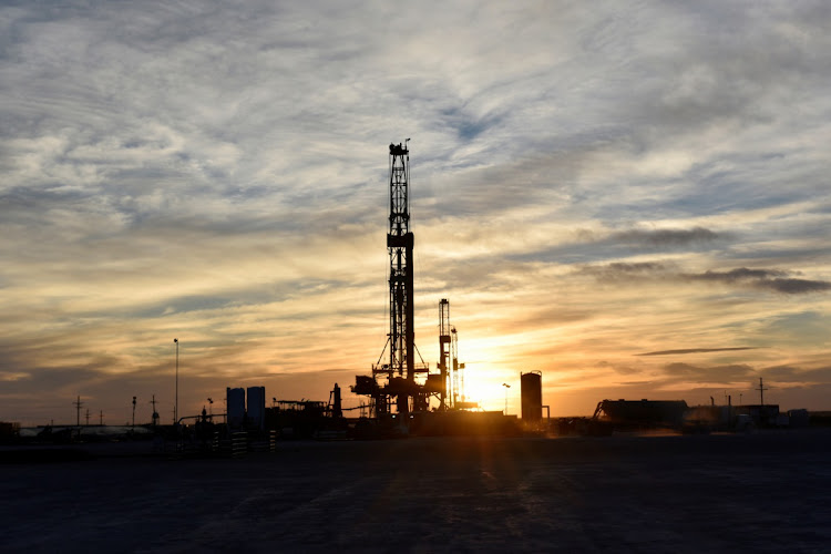 Drilling rigs operate at sunset in Midland, Texas, US. Fie photo: REUTERS/NICK OXFORD
