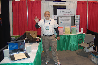 Photo: Bob Harris has the Christian College of Georgia booth ready in the exhibit hall.