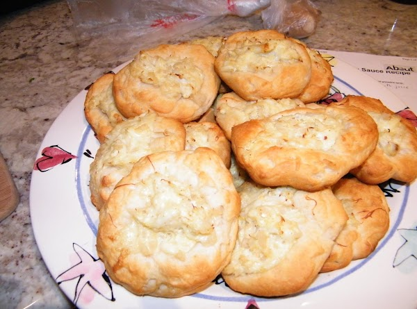 Put a tablespon of the crab meat mixture on each biscuit.  Bake at...