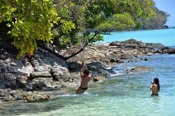 Tarzan swinging at the beach of Koh Rok Nai